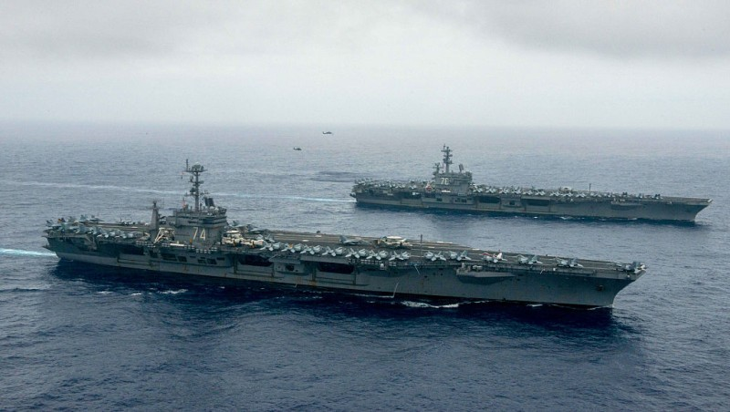 PHILIPPINE SEA - JUNE 18:  In this handout provided by the U.S. Navy, The Nimitz-class aircraft carriers USS John C. Stennis (CVN 74), center, and USS Ronald Reagan (CVN 76) conduct dual aircraft carrier strike group operations in the U.S. 7th Fleet area of operations in support of security and stability in the Indo-Asia-Pacific.  (Photo by Specialist 3rd Class Jake Greenberg/U.S. Navy via Getty Images)