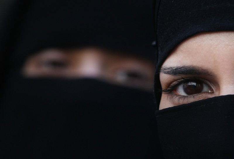 LONDON, ENGLAND - APRIL 11:  Two women wearing Islamic niqab veils stand outside the French Embassy during a demonstration on April 11, 2011 in London, England. France has become the first country in Europe to ban the wearing of the veil and in Paris two women have been detained by police under the new law.  (Photo by Peter Macdiarmid/Getty Images)