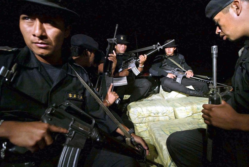 GUATEMALA, GUATEMALA:  Members of the antidrug squad of Guatemala's Civil National Police, transport at the Air Force base in Guatemala City around a ton of cocaine, seized in Peten, a department on the border with Mexico, 25 January 2004.       AFP PHOTO/Orlando SIERRA  (Photo credit should read ORLANDO SIERRA/AFP/Getty Images)
