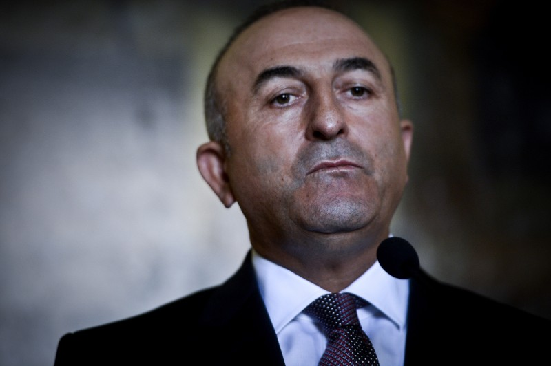 Turkish foreign minister Mevlut Cavusoglu listends to the Portuguese foreign minister during a press conference following their meeting at Necessidades Palace in Lisbon on July 27, 2015. After months of hesitation, Turkey started to take decisive action against Islamic State jihadists and has seized the chance to also attack Kurdish militants in strikes that put a fragile peace process at risk. AFP PHOTO / PATRICIA DE MELO MOREIRA        (Photo credit should read PATRICIA DE MELO MOREIRA/AFP/Getty Images)