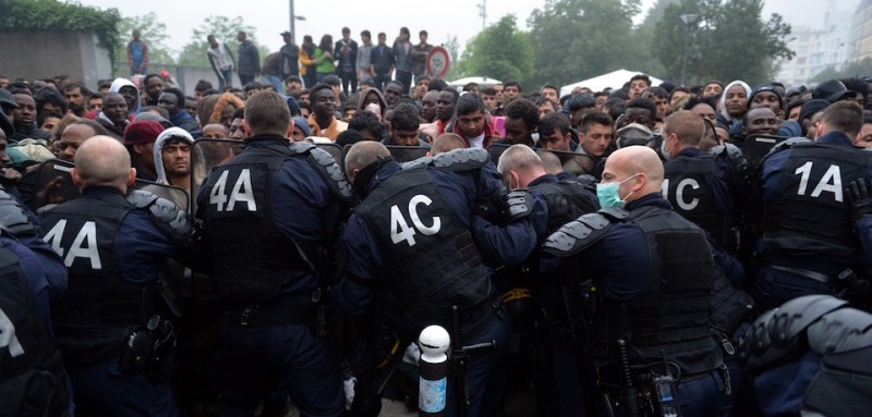 PARIS, FRANCE - JUNE 6: French police are seen as thousands of refugees living in the tents are evacuated at the 18th arrondissement of Paris, France on June 6, 2016. Refugees have been sent to a temporary shelter.  (Photo by )