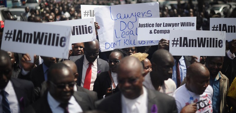 Hundreds of Kenyan lawyers march down a street in Nairobi on July 6, 2016 to protest against the extrajudicial killings of three men including a rights lawyer by Kenyan police.  The bodies of lawyer Willie Kimani -- who had criticised police abuse -- as well as his client Josephat Mwenda and driver Joseph Muiruri were found Friday wrapped in sacks and dumped in a river.  / AFP / TONY KARUMBA        (Photo credit should read TONY KARUMBA/AFP/Getty Images)