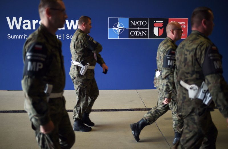 Soldiers walk at the national stadium where the NATO summit takes place in Warsaw, Poland on July 9, 2016. The Polish capital hosts a two-day NATO summit, the first time ever that it hosts a top-level meeting of the Western military alliance which it joined in 1999. / AFP / STEPHANE DE SAKUTIN        (Photo credit should read STEPHANE DE SAKUTIN/AFP/Getty Images)