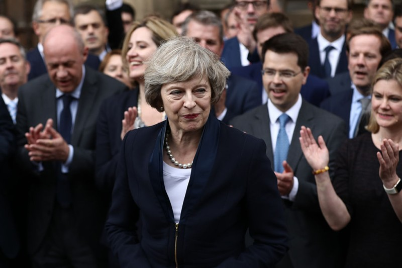 LONDON, ENGLAND - JULY 11:  People clap as British Home Secretary Theresa May makes a statement after Andrea Leadsom pulled out of the contest earlier today to become Conservative Party leader outside the Houses of Parliament on July 11, 2016 in London, England. Theresa May will become the UK's new Prime Minister on Wednesday evening after David Cameron holds his final PMQs and visits the Queen to officially resign his position.  (Photo by Carl Court/Getty Images)