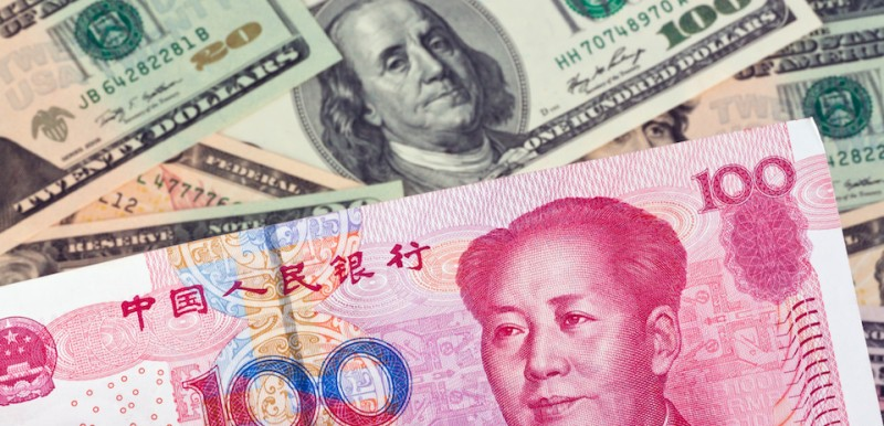 (GERMANY OUT) Chinese Yuan Renminbi and Dollar banknotes with portraits of Mao Zedong and Benjamin Franklin  (Photo by Wodicka/ullstein bild via Getty Images)