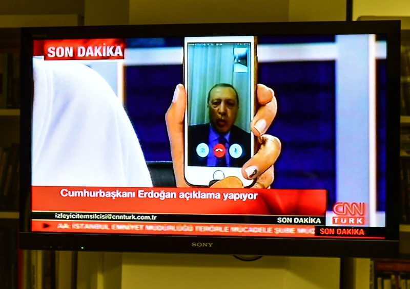 ISTANBUL, TURKEY - JULY 16: Turkish President Recep Tayyip Erdogan speaks on CNNTurk via a Facetime call in the early morning hours of July 16, 2016 in Istanbul, Turkey. Istanbul's bridges across the Bosphorus, the strait separating the European and Asian sides of the city, have been closed to traffic. Reports have suggested that a group within Turkey's military have attempted to overthrow the government. Security forces have been called in as Turkey's Prime Minister Binali Yildirim denounced an 'illegal action' by a military 'group', with bridges closed in Istanbul and aircraft flying low over the capital of Ankara. (Photo by Burak Kara/Getty Images)
