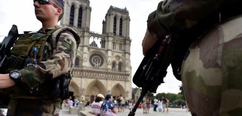 Armed French Naval Fusiliers, part of Operation Sentinelle, patrol near the Notre Dame cathedral in Paris on July 20, 2016. / AFP / ALAIN JOCARD        (Photo credit should read )