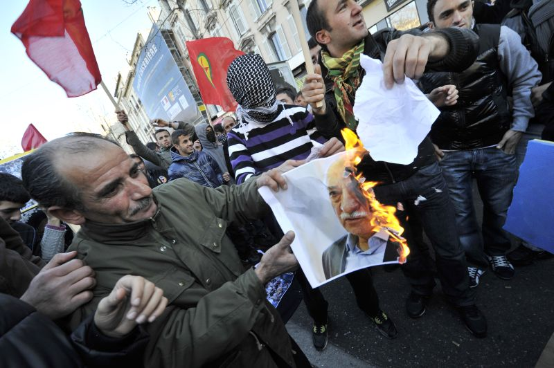 Members of the Kurdish community in France burn a portrait of Turkish writer Fethullah Gulen on December 30, 2011 in Marseille, southern France, during a protest against an air strike by Turkish air force on the border with Iraq in southeastern Turkey that killed 35 Kurdish villagers. AFP PHOTO / BORIS HORVAT (Photo credit should read BORIS HORVAT/AFP/Getty Images)
