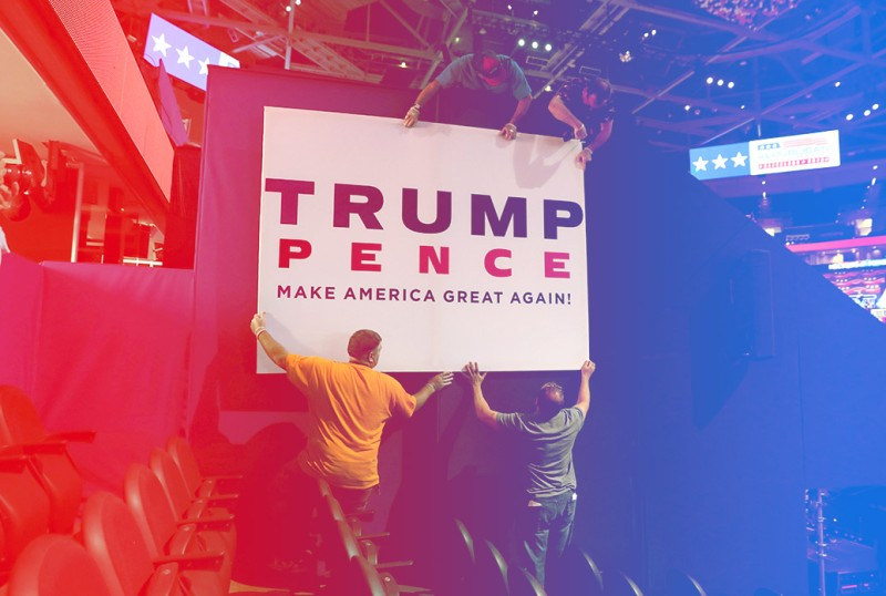 CLEVELAND, OH - JULY 17:  Workers hang campaign signs in the Quicken Loans Arena a day before the start of the Republican National Convention on July 17, 2016 in Cleveland, Ohio. The convention is set to run from July 18-21.  (Photo by John Moore/Getty Images)