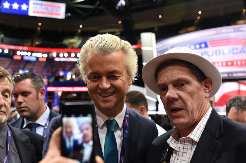Dutch politician Gert Wilders poses for a photograph with an unidentified man on the convention floor before the start of the second day of the Republican National Convention on July 19, 2016 at Quicken Loans Arena in Cleveland, Ohio. About 50,000 people are expected in Cleveland this week for the Republican National Convention, at which Donald Trump is expected to be formally nominated to run for the US presidency in November. / AFP / Robyn BECK        (Photo credit should read ROBYN BECK/AFP/Getty Images)