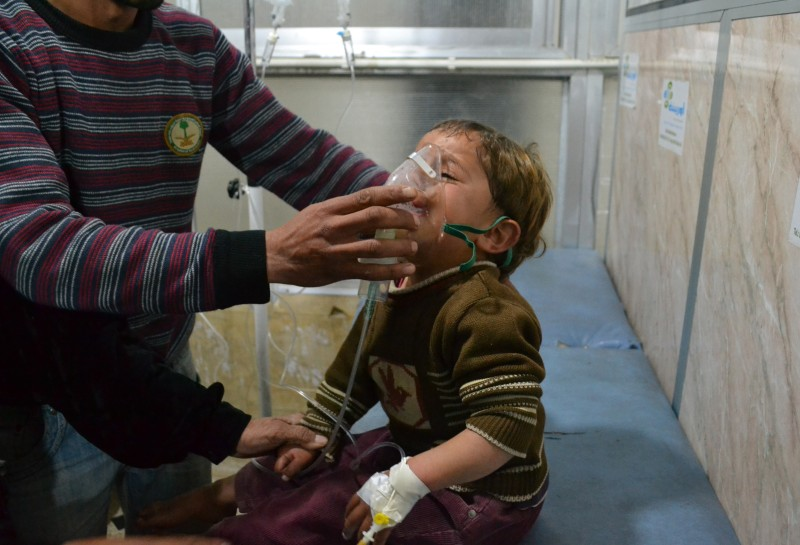 IDLIB, SYRIA - APRIL 27: A Syrian boy receives treatment at a local hospital following a suspected chlorine gas attack by Asad regime forces in Jebel ez Zawiye, Idlib, Syria on April 27, 2015. (Photo by Firas Taki/Anadolu Agency/Getty Images)