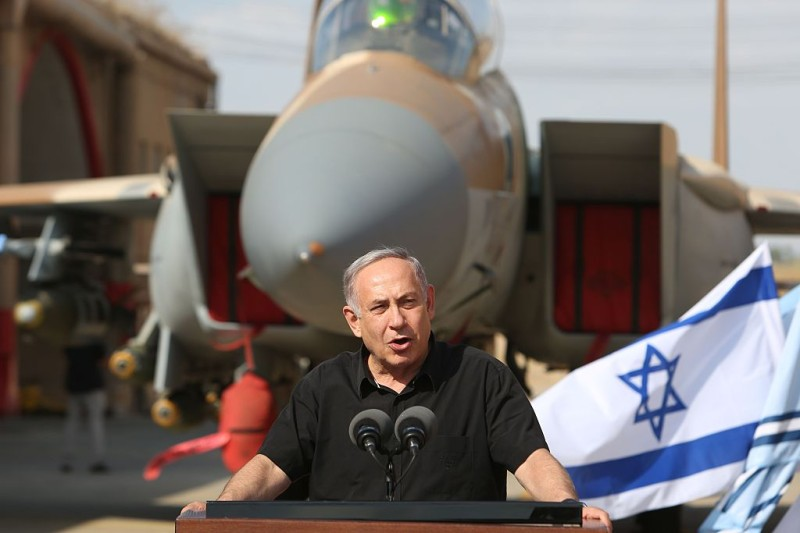 Israeli Prime Minister Benjamin Netanyahu speaks to the press during a visit to the Tel Nof Air Force base near the city of Rehovot in central Israel on August 17, 2016. / AFP / MENAHEM KAHANA        (Photo credit should read MENAHEM KAHANA/AFP/Getty Images)