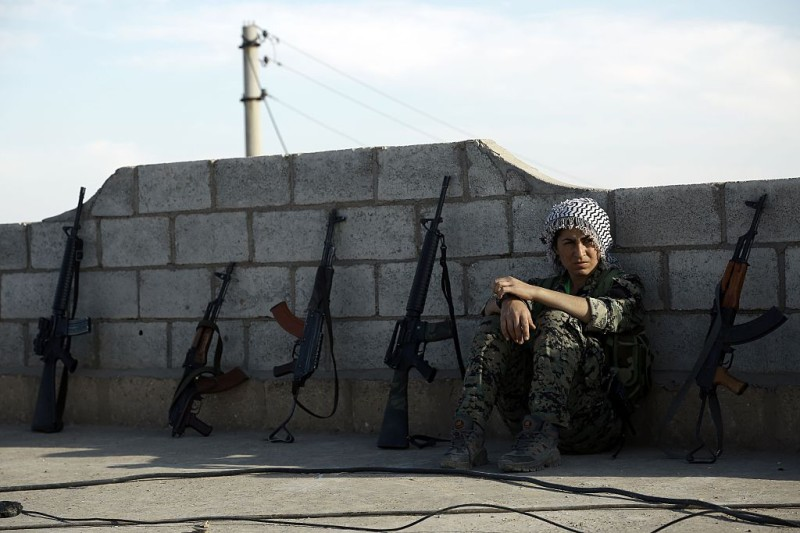 TOPSHOT - A fighter from the Syrian Democratic Forces (SDF) rests on a rooftop on the outskirts of the town of al-Shadadi in the northeastern Syrian province of Hasakeh, on February 19, 2016. The Syrian Democratic Forces (SDF), an alliance dominated by the Kurdish People's Protection Units (YPG), seized on Friday the town of al-Shadadi, a bastion of the Islamic State group (IS) in the Hasakeh province, in northeastern Syria, according to the Syrian Observatory for Human Rights. / AFP / Delil souleiman        (Photo credit should read DELIL SOULEIMAN/AFP/Getty Images)