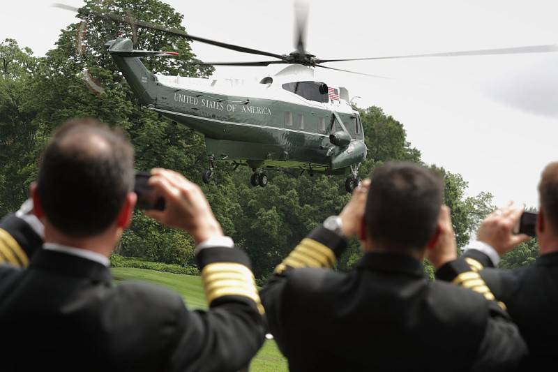 WASHINGTON, DC - JUNE 03:  U.S. Navy officers photograph Marine One as it lifts off the South Lawn with President Barack Obama on board at the White House June 3, 2016 in Washington, DC. Obama is traveling to Miami, FL, to attend Democratic National Committee meetings and fundraisers and then overnighting in Palm City.  (Photo by Chip Somodevilla/Getty Images)