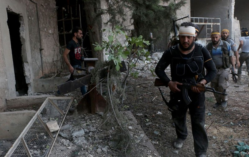 ALEPPO, SYRIA - AUGUST 06: Members of anti-regimist opposition forces group named Jaish al-Fatah, clash with Assad Regime soldiers based at Syrian Army Artillery School and military academy in Ramouseh region of Aleppo, Syria on August 06, 2016. Syrian opposition forces has started an operation to break Assad forces' siege over Aleppo. (Photo by Beha El Halebi/Anadolu Agency/Getty Images)