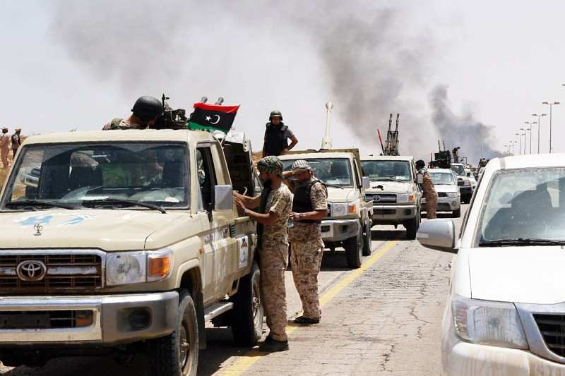 Smoke billows at the entrance of Sirte as forces loyal to Libya's UN-backed unity government advance to recapture the city from the Islamic State (IS) group jihadists on June 10, 2016. Forces loyal to Libya's unity government fought streets battles with the Islamic State group as they pressed an offensive to recapture their coastal bastion. The loss of Sirte, the hometown of ousted dictator Moamer Kadhafi, would be a major blow to the jihadists at a time when they are under mounting pressure in Syria and Iraq. / AFP / MAHMUD TURKIA        (Photo credit should read MAHMUD TURKIA/AFP/Getty Images)