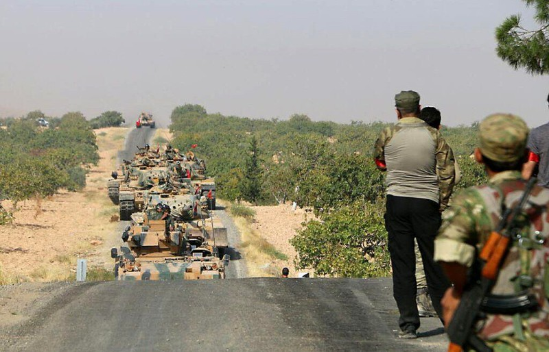 """JARABLUS, SYRIA - AUGUST 24: Turkish military tanks are seen in Jarabulus, Syria during the """"Operation Euphrates Shield"""" on August 24, 2016. The anti-Daesh operation, called Euphrates Shield, is aimed at clearing terrorist groups from the Turkish border region, tightening border security, and supporting Syrias territorial integrity.  (Photo by Firas Faham /Anadolu Agency/Getty Images)"""