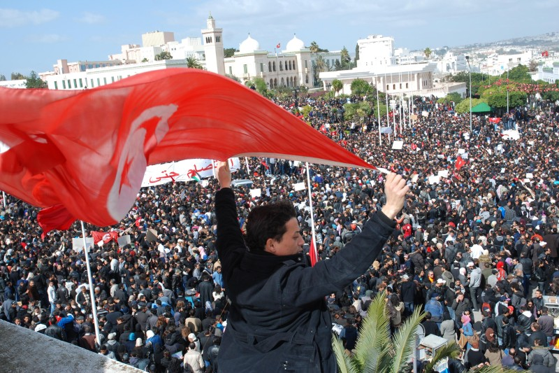 Thousnads of demonstrators gather at the Kasba in Tunis on Febuary 25, 2011. Tens of thousands of Tunisians rallied today to demand the resignation of Prime Minister Mohamed Ghannouchi's transitional government set up after last month's ouster of Zine el Abidine Ben Ali. AFP PHOTO / BORNI Hichem (Photo credit should read BORNI Hichem/AFP/Getty Images)