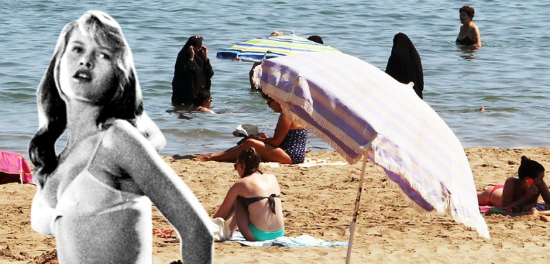 "A photo taken on June 4, 2015 shows two Muslim women wearing chador as they enjoy their time with other people  a beach of Narbne, southern France. The decision by a handful of French mayors to ban the Islamic burkini swimsuit, which covers the body and hair, has divided the country and shocked its neighbours, with critics seeing the prohibitions as profoundly discriminatory. On August 17, 2016, Prime Minister Manuel Valls waded into the debate, saying the garment was ""not compatible with the values of France and the Republic"" and that he supported towns that banned it.   / AFP / Raymond ROIG        (Photo credit should read RAYMOND ROIG/AFP/Getty Images)"