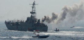 "CORRECTING NAME OF THE GULF IN IPTC Members of Iran's elite Revolutionary Guard show their skills in attacking a naval vessel during military exercises in the Gulf on April 22, 2010. Iran's elite Revolutionary Guards launched a new ""ultra-fast"" boat capable of causing high destruction after testing it in a key oil supply route, at the start of a three-day military drill.  AFP PHOTO/FARS NEWS/MEHDI MARIZAD (Photo credit should read )"