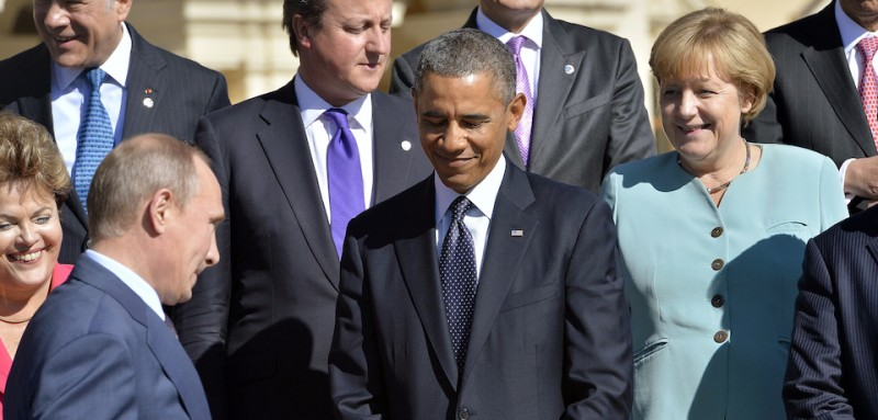 Russias President Vladimir Putin (2ndL) walks past US President Barack Obama (C), Brazils President Dilma Rousseff (L) and Germanys Chancellor Angela Merkel (R) as he arrives to pose for the family photo during the G20 summit on September 6, 2013 in Saint Petersburg. World leaders at the G20 summit on Friday failed to bridge their bitter divisions over US plans for military action against the Syrian regime, with Washington signalling that it has given up on securing Russia's support at the UN on the crisis.    AFP PHOTO / JEWEL SAMAD        (Photo credit should read JEWEL SAMAD/AFP/Getty Images)