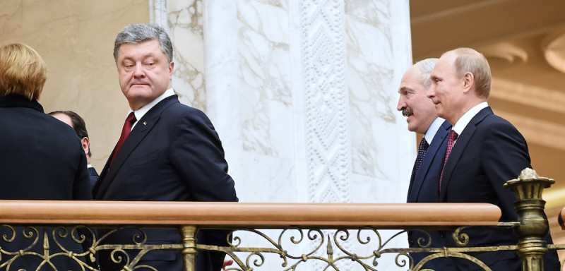 MISNK, BELARUS - FEBRUARY 11: (L to R) Ukrainian President Pyotr Poroshenko,  Belarus President Alexander Lukashenko, Russian President Vladimir Putin  during peace talks over Eastern Ukraine on February 11, 2015 in Minsk, Belarus. The European leaders are meeting to discuss a cease-fire in the Ukraine. (Photo by Dmitry Azarov/Kommersant Photo via Getty Images).