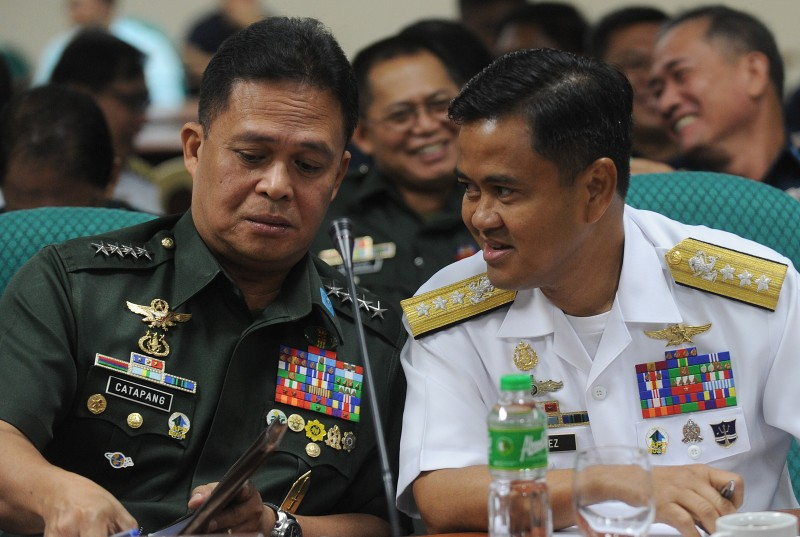 Gen. Gregorio Pio Catapang, Chief of Staff of the Armed Forces of the Philippines, talks to Vice Admiral Alexander Lopez, Commander of Western Command, during a Senate Inquiry of the disputed islands at the South China Sea in Manila on May 7, 2015.  The Philippines claimed that increased attempts by China to drive off Filipino aircraft from a disputed South China Sea island garrisoned by Manila have raised the prospect of a confrontation.  AFP PHOTO / Jay DIRECTO        (Photo credit should read JAY DIRECTO/AFP/Getty Images)