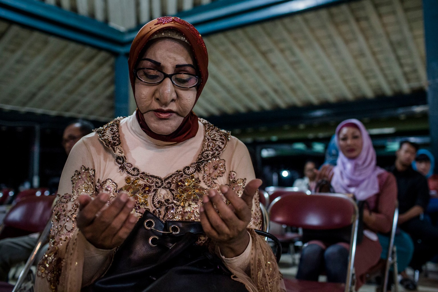YOGYAKARTA, INDONESIA - AUGUST 12: Shinta Ratri, a leader of a Pesantren boarding school, Al-Fatah, for transgender people known as 'waria' prays during Syawalan tradition on August 12, 2015 in Yogyakarta, Indonesia. Syawalan tradition is recognized by the Javanese community as a part of religious traditions as celebrates after the Eid al-Fitr, as all sins forgiven to get back into the pure and clean. During the Syawalan tradition the 'waria' community gather to celebrates. 'Waria' is a term derived from the words 'wanita' (woman) and 'pria' (man). The Koran school Al-Fatah was set back last year's by Shinta Ratri at her house as a place for waria to pray, after their first founder Maryani died. The school operates every Sunday. Islam strictly segregates men from women when praying, leaving no-where for 'the third sex' waria to pray before now. (Photo by Ulet Ifansasti/Getty Images)