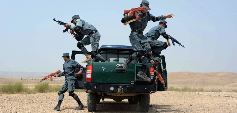 Afghan policemen perform a drill during exercises as part of their graduation ceremony at a police training centre on the outskirts of Jalalabad, in Nangarhar province on August 16, 2015. AFP PHOTO / Noorullah Shirzada        (Photo credit should read Noorullah Shirzada/AFP/Getty Images)