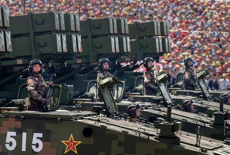 BEIJING, CHINA - SEPTEMBER 03:  Chinese soldiers ride on armoured missile carriers as they pass in front of Tiananmen Square and the Forbidden City during a military parade on September 3, 2015 in Beijing, China. China is marking the 70th anniversary of the end of World War II and its role in defeating Japan with a new national holiday and a military parade in Beijing.  (Photo by Kevin Frayer/Getty Images)