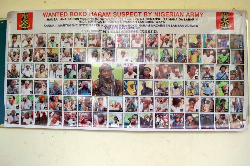 A photo taken on October 28, 2015  in Maiduguri shows a poster displaying one hundred Boko Haram suspects declared wanted by the Nigerian army. The Nigerian army on October 28 said it had freed more than 330 people, mostly women and children, from Boko Haram's Sambisa forest stronghold in the volatile northeast. AFP PHOTO / STRINGER        (Photo credit should read -/AFP/Getty Images)