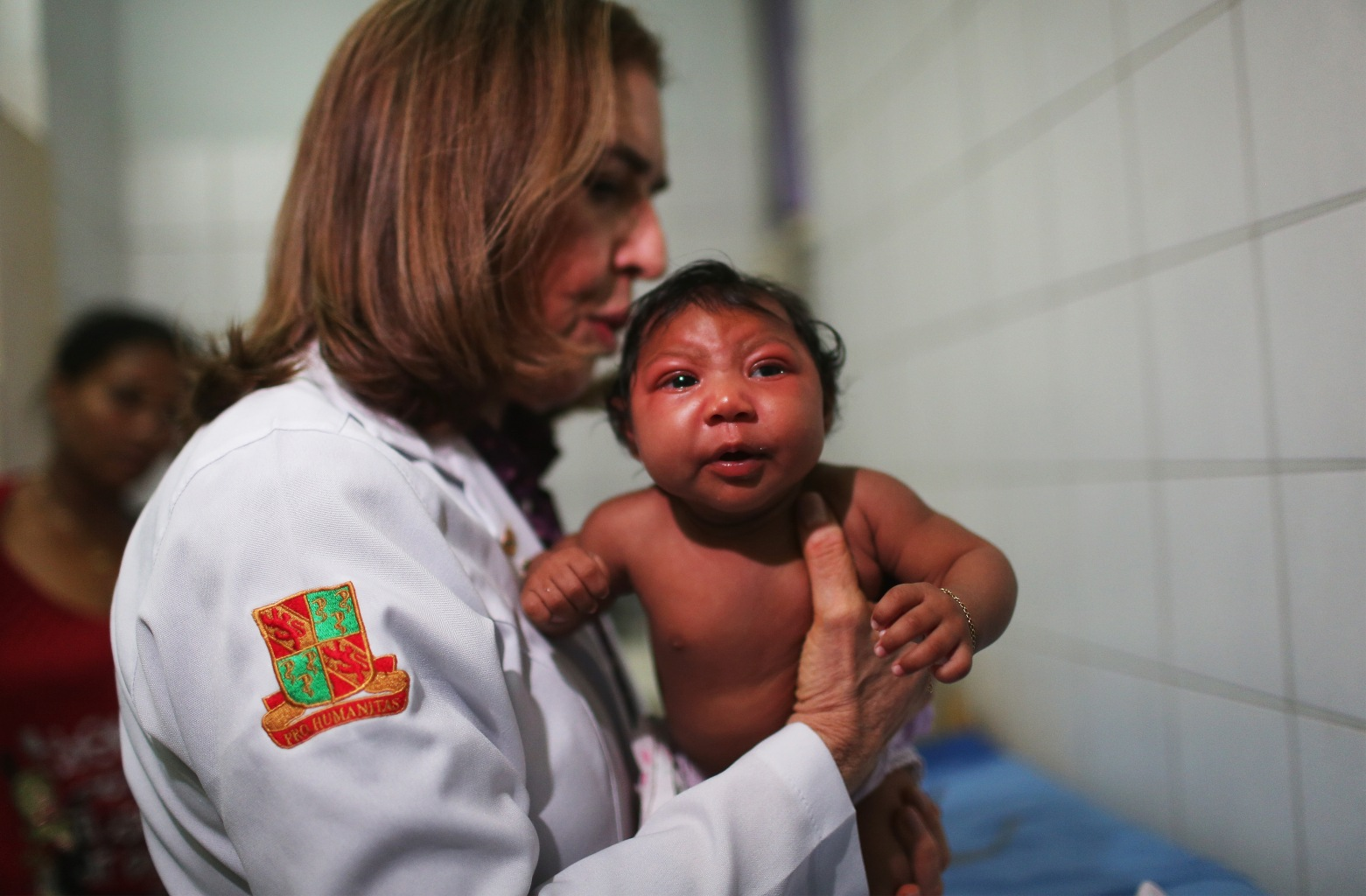 RECIFE, BRAZIL - JANUARY 26: Dr. Angela Rocha (C), pediatric infectologist at Oswaldo Cruz Hospital, examines Ludmilla Hadassa Dias de Vasconcelos (2 months), who has microcephaly, on January 26, 2016 in Recife, Brazil. In the last four months, authorities have recorded close to 4,000 cases in Brazil in which the mosquito-borne Zika virus may have led to microcephaly in infants. The ailment results in an abnormally small head in newborns and is associated with various disorders including decreased brain development. According to the World Health Organization (WHO), the Zika virus outbreak is likely to spread throughout nearly all the Americas. At least twelve cases in the United States have now been confirmed by the CDC. Brazil reported the first cases in the Americas of local transmissions of the virus last year. (Photo by Mario Tama/Getty Images)