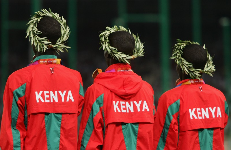 ATHENS - AUGUST 24:  Gold medalist Ezekiel Kemboi of Kenya, silver medalist Brimin Kipruto of Kenya (R) and bronze medalist Paul Kipsiele Koech of Kenya celebrate on the podium during the medal ceremony of the 3,000 metre steeplechase medal ceremony on August 24, 2004 during the Athens 2004 Summer Olympic Games at the Olympic Stadium in the Sports Complex in Athens, Greece..  (Photo by Adam Pretty/Getty Images)