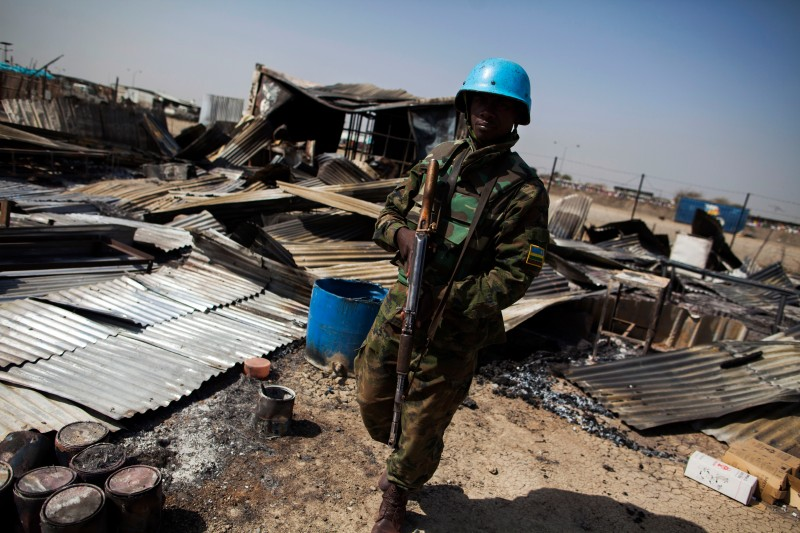 A UN peacekeeper from Rwanda walks through the remnants of a looted and burnt clinic in the UN Protection of Civilians (PoC) site in Malakal, on February 26, 2016. The United States forcefully condemned fatal clashes at a United Nations compound sheltering civilians in South Sudan and urged authorities to investigate the incident, which witnesses said involved government troops. At least 18 people and more than 70 others were wounded in the violence Wednesday to Thursday at the camp in the town of Malakal, the aid group Doctors Without Borders (MSF) has said.    / AFP / Albert Gonzalez Farran        (Photo credit should read ALBERT GONZALEZ FARRAN/AFP/Getty Images)
