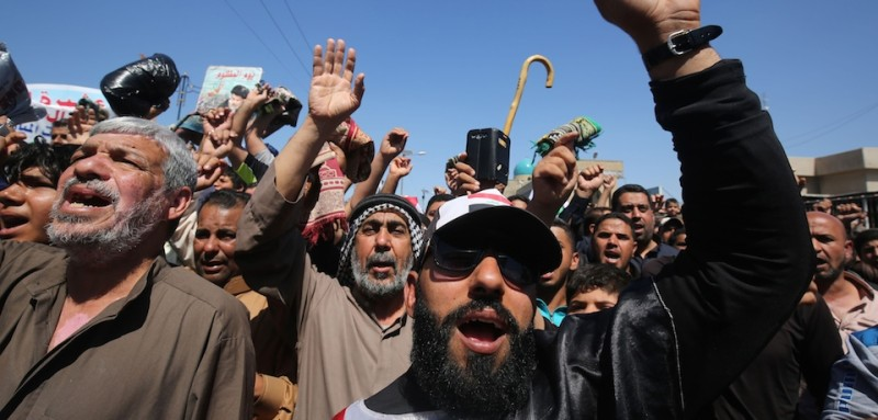 Iraqi supporters of Moqtada al-Sadr shout slogans during a protest against corruption in Baghdad's Sadr City April 1, 2016, a day after the influential Shiite cleric ordered his followers to end a two-week sit-in in the capital calling for government reform.  Sadr ordered his followers to end the sit-in on March 31 after the country's premier proposed new ministers for a technocratic cabinet that he had demanded. / AFP / AHMAD AL-RUBAYE        (Photo credit should read AHMAD AL-RUBAYE/AFP/Getty Images)