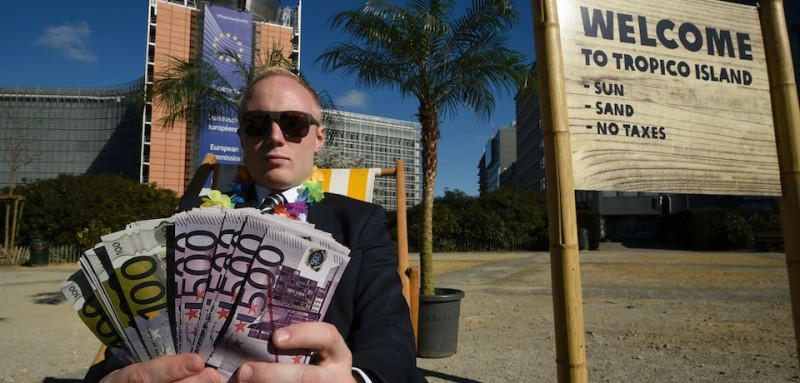 An activist performs as a client of an offshore company during a protest of the non-governmental organizations 'Oxfam' and 'Transparency International' in front of the European Commission headquarters in Brussels, on April 12, 2016.   Following the Panama Papers revelations, Oxfam criticizes the EU Commission's delay of financial reforms. Commissioner Jonathan Hill is expected to present a list of reforms in Strasbourg, France, later on April 12. / AFP / JOHN THYS        (Photo credit should read JOHN THYS/AFP/Getty Images)