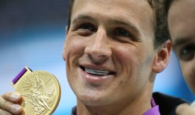 Olympic gold medalist Ryan Lochte shows off his American flag grills and gold medal after winning the Men's 400m Individual Medley at the London 2012 Olympics Aquatic Center.  (Photo by Robert Gauthier/Los Angeles Times via Getty Images)