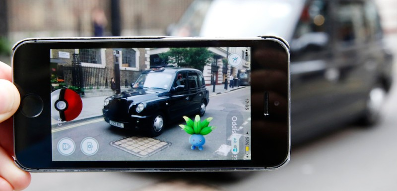 LONDON, ENGLAND - JULY 15:  An Oddish Pokemon character appears in front of a London taxi during a game of Pokemon Go, a mobile game that has become a global phenomenon, on July 15, 2016 in London, England. The app lets players roam using their phone's GPS location data and catch Pokemon to train and battle.The game has added millions to the value of Nintendo, which part-owns the franchise. (Photo by )