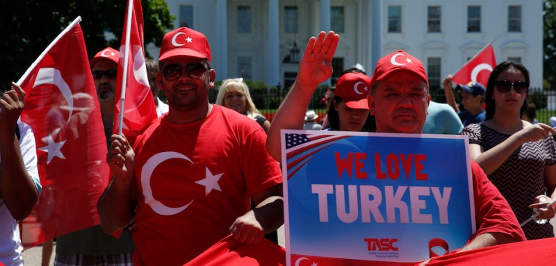 Supporters of Turkish President Recep Tayip Erdogan rally outside the White House in Washington, DC on July 17, 2016.  President Recep Tayyip Erdogan said on Sunday that Turkey would consider reinstating the death penalty after the attempted coup. / AFP / YURI GRIPAS        (Photo credit should read YURI GRIPAS/AFP/Getty Images)