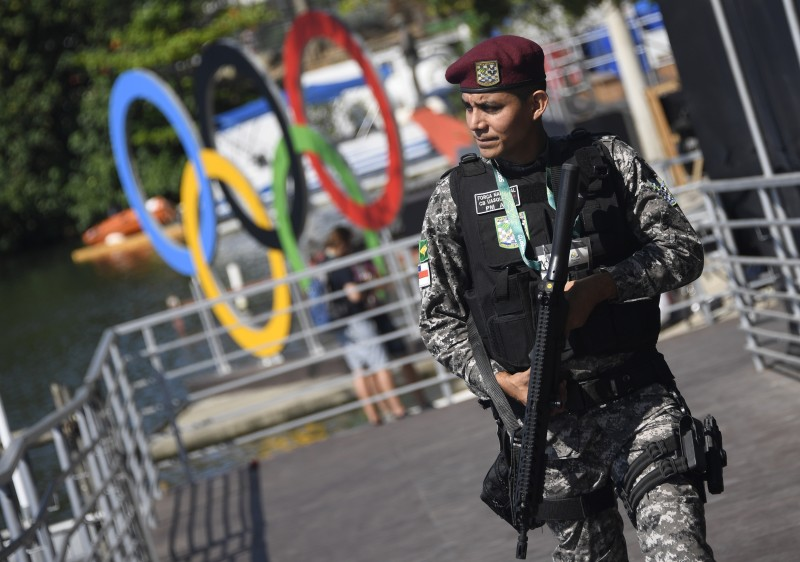 A Brazilian soldier patrol at the rowing venue Lagoa stadium in Rio de Janeiro on August 5, 2016 ahead of the Rio 2016 Olympic Games. / AFP / DAMIEN MEYER        (Photo credit should read DAMIEN MEYER/AFP/Getty Images)