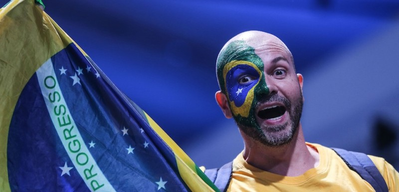 RIO DE JANEIRO, BRAZIL - AUGUST 05: A Brazilian fan gestures during the Opening Ceremony of the Rio 2016 Olympic Games at Maracana Stadium in Rio de Janeiro, Brazil on August 05, 2016.   (Photo by Salih Zeki Fazlioglu/Anadolu Agency/Getty Images)