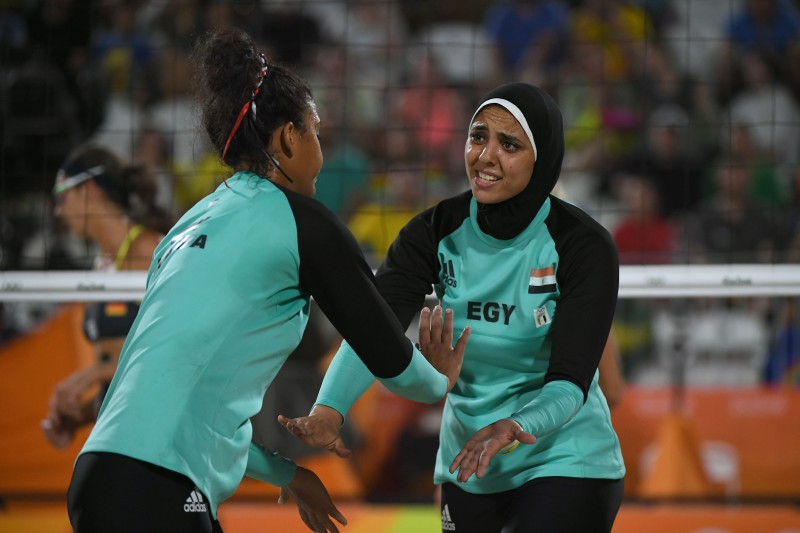 Egypt's Nada Meawad (L) and Egypt's Doaa Elghobashy react during the women's beach volleyball qualifying match between Germany and Egypt at the Beach Volley Arena in Rio de Janeiro on August 7, 2016, for the Rio 2016 Olympic Games. / AFP / Yasuyoshi Chiba        (Photo credit should read YASUYOSHI CHIBA/AFP/Getty Images)