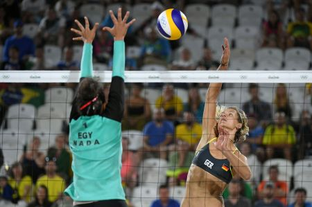 Germany's Laura Ludwig (R) vies with Egypt's Nada Meawad during the women's beach volleyball qualifying match between Germany and Egypt at the Beach Volley Arena in Rio de Janeiro on August 7, 2016, for the Rio 2016 Olympic Games. / AFP / Yasuyoshi Chiba (Photo credit should read YASUYOSHI CHIBA/AFP/Getty Images)