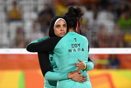 RIO DE JANEIRO, BRAZIL - AUGUST 07: Doaa Elghobashy of Egypt hugs teammate Nada Meawad during the Women's Beach Volleyball preliminary round Pool D match against Laura Ludwig and Kira Walkenhorst of Germany on Day 2 of the Rio 2016 Olympic Games at the Beach Volleyball Arena on August 7, 2016 in Rio de Janeiro, Brazil. (Photo by Shaun Botterill/Getty Images)