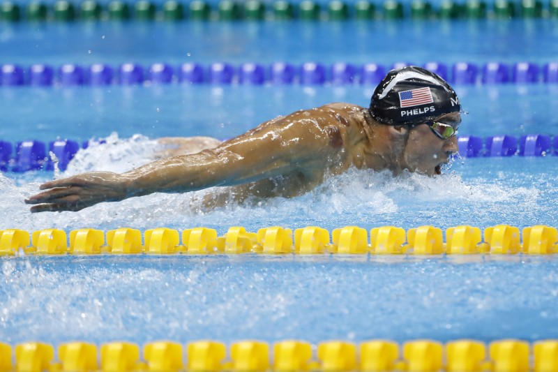 USA's Michael Phelps competes in the Men's 200m Butterfly Semifinal during the swimming event at the Rio 2016 Olympic Games at the Olympic Aquatics Stadium in Rio de Janeiro on August 8, 2016.   / AFP / Odd Andersen        (Photo credit should read ODD ANDERSEN/AFP/Getty Images)