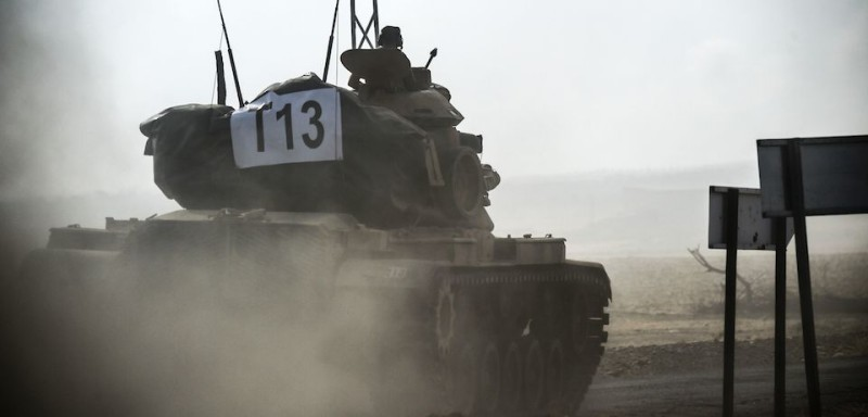 This picture taken on August 24, 2016 shows a Turkish army tank driving towards Syria  in the Turkish-Syrian border city of Karkamis, in the southern region of Gaziantep. Turkey's army backed by international coalition air strikes launched an operation involving fighter jets and elite ground troops to drive Islamic State jihadists out of a key Syrian border town. / AFP / BULENT KILIC        (Photo credit should read BULENT KILIC/AFP/Getty Images)