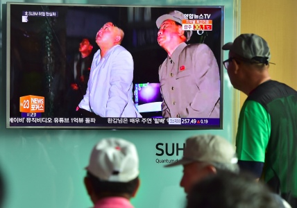 """People watch a television screen reporting news of North Korea's latest submarine-launched ballistic missile test at a railway station in Seoul on August 25, 2016. North Korean leader Kim Jong-Un declared a recent submarine-launched ballistic missile (SLBM) test the """"greatest success"""", Pyongyang's state media said on August 25. / AFP / JUNG YEON-JE (Photo credit should read JUNG YEON-JE/AFP/Getty Images)"""