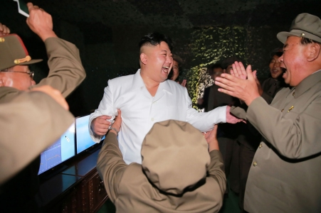 """This undated picture released from North Korea's official Korean Central News Agency (KCNA) on August 25, 2016 shows North Korean leader Kim Jong-Un (C) laughing as he inspects a test-fire of strategic submarine-launched ballistic missile at an undisclosed location. / AFP / KCNA / KNS / South Korea OUT / REPUBLIC OF KOREA OUT / SOUTH KOREA OUT ---EDITORS NOTE--- RESTRICTED TO EDITORIAL USE - MANDATORY CREDIT """"AFP PHOTO/KCNA VIA KNS"""" - NO MARKETING NO ADVERTISING CAMPAIGNS - DISTRIBUTED AS A SERVICE TO CLIENTS THIS PICTURE WAS MADE AVAILABLE BY A THIRD PARTY. AFP CAN NOT INDEPENDENTLY VERIFY THE AUTHENTICITY, LOCATION, DATE AND CONTENT OF THIS IMAGE. THIS PHOTO IS DISTRIBUTED EXACTLY AS RECEIVED BY AFP. / (Photo credit should read KNS/AFP/Getty Images)"""