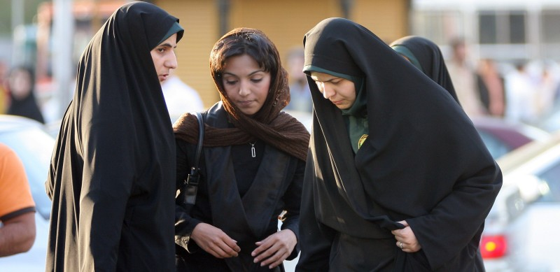 policewoman (R) warns a woman about the state of her clothing and hair during a crackdown on adhering to the strict Islamic dress code in Tehran April 22, 2007