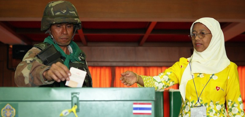 PATTANI, THAILAND - AUGUST 19: A Thai soldier casts his vote in Thailand's first referendum for a new draft constitution on August 19, 2007 in Pattani Province, Thailand. Some 45 million voters were asked to vote in the kingdon's first-ever referendum to accept or reject a constitution drafted by the military-appointed committee in the wake of September 19, 2006 coup that ousted former premier Thaksin Shinawatra.  (Photo by Chumsak Kanoknan/Getty Images)